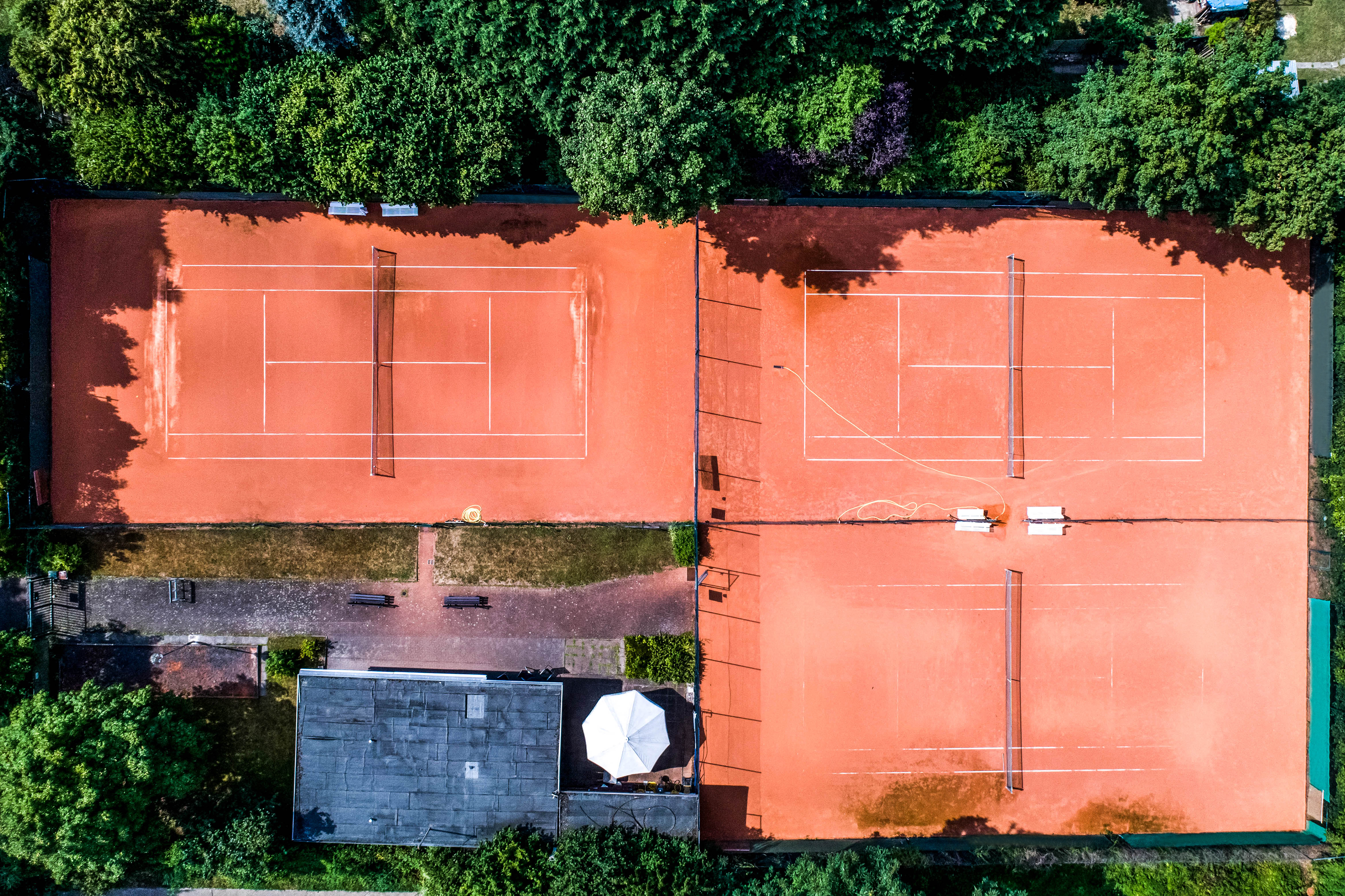 aerial view of a smal local Tennis courts for recreation and tennis training. Sporting area outdoors seen from above.
