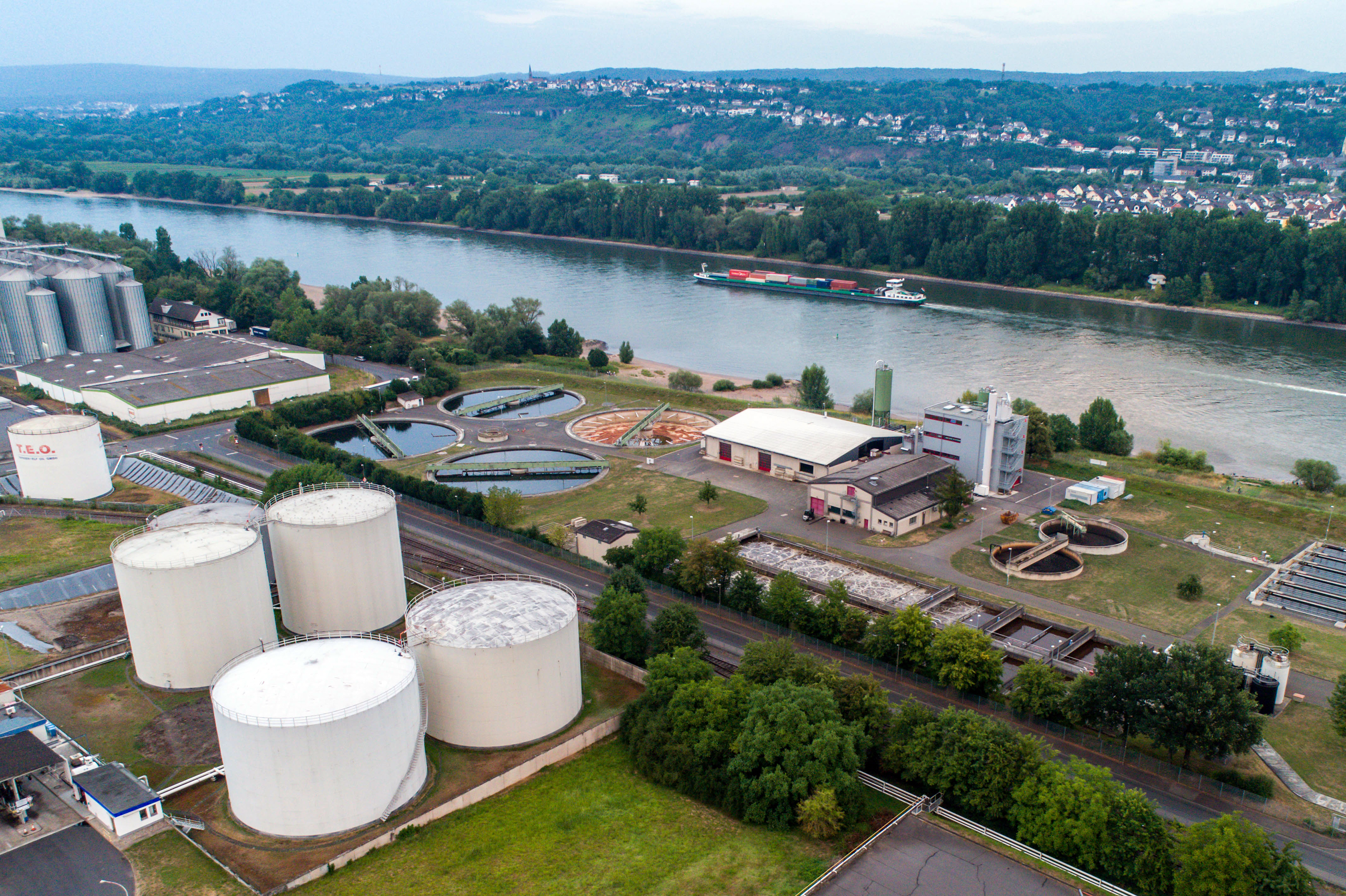 Koblenz GERMANY 21.07.2018 Aerial view of modern industrial sewage treatment plant beside the rhine river.