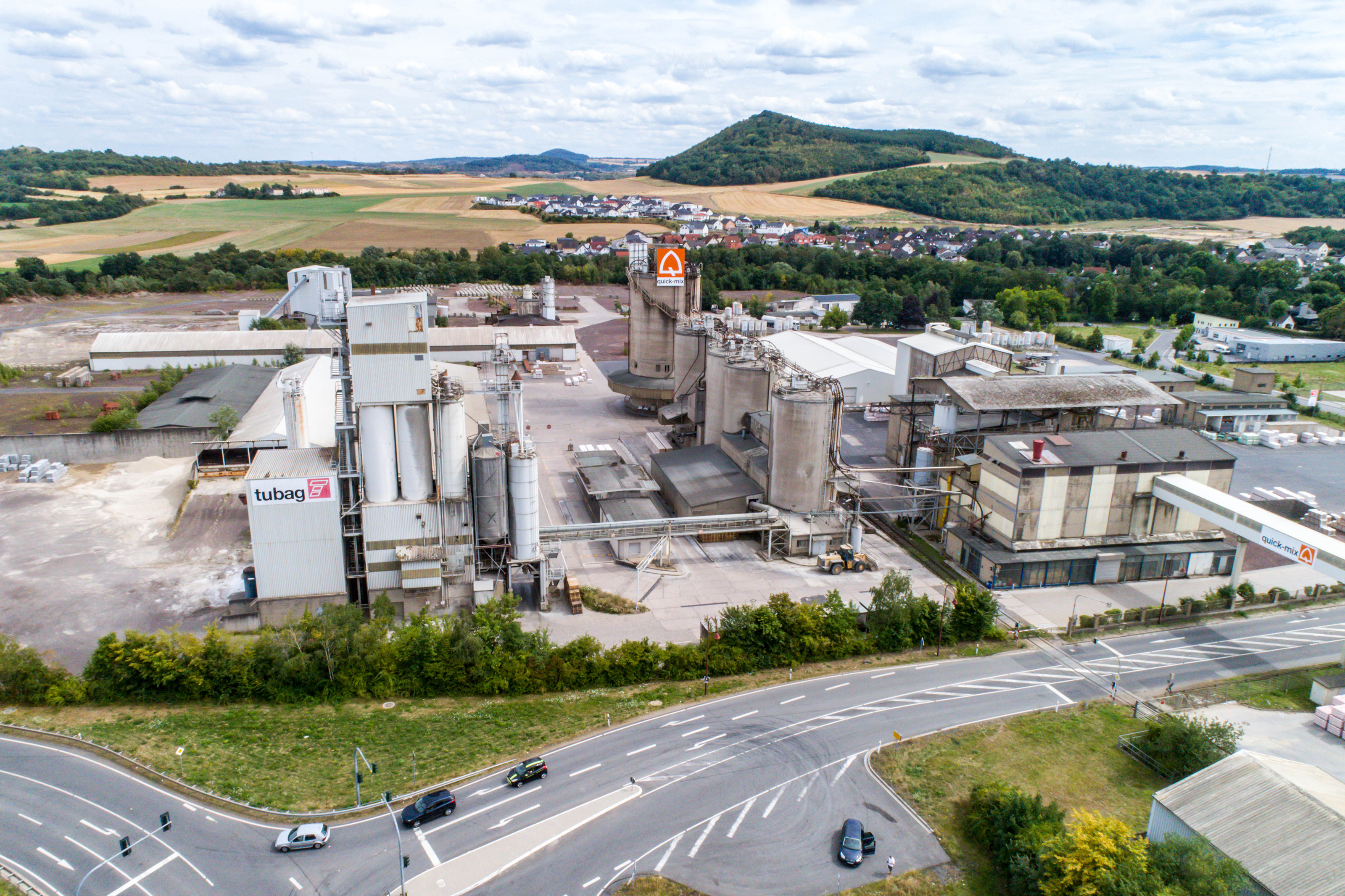 Koblenz GERMANY 21.07.2018 - Quickmix Concrete Batching Plant and construction material factory aerial view.