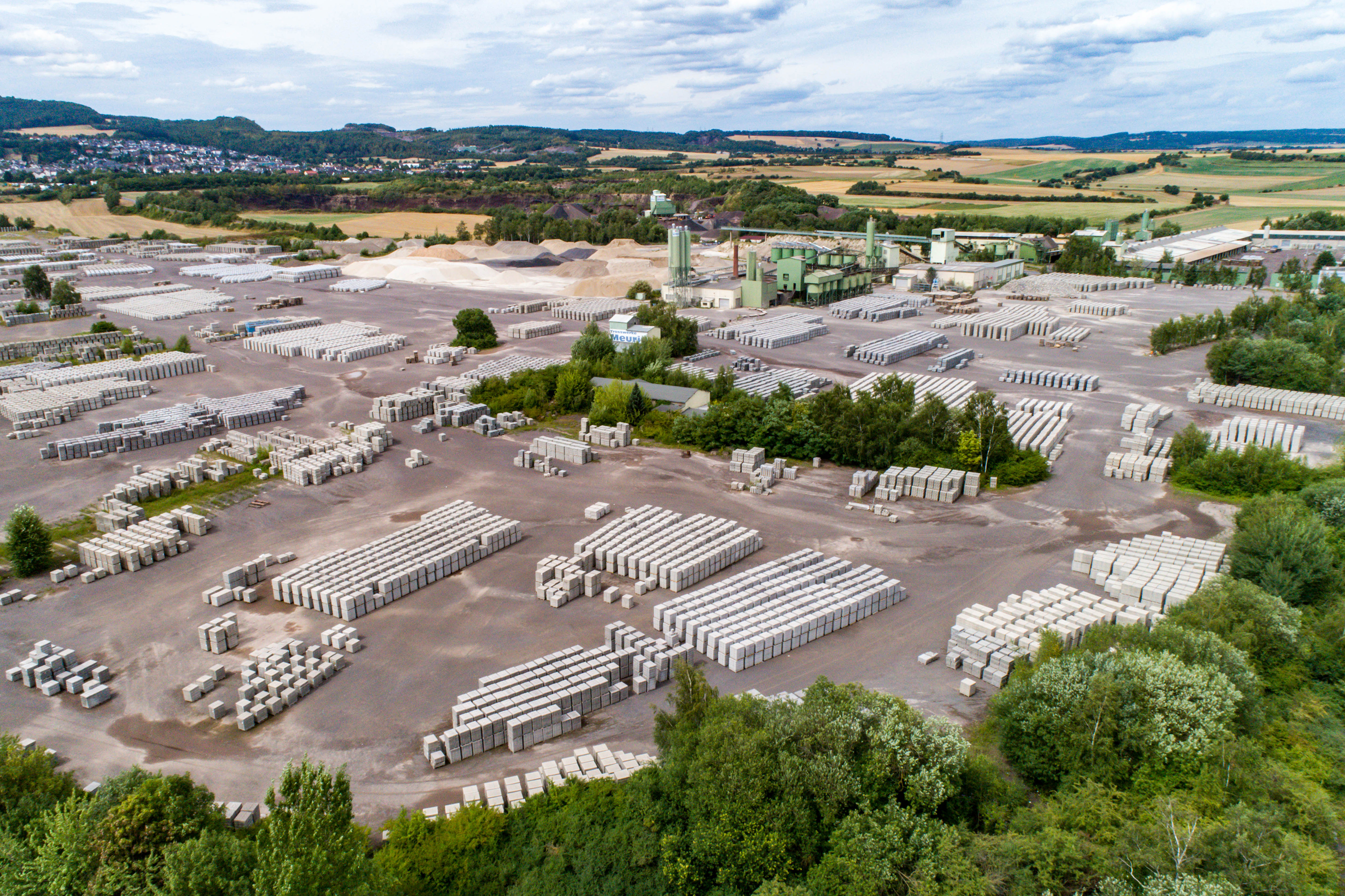 Koblenz, Germany 21.07.2018 Aerial view of factory for Blocks of concrete stones Building materials industry products for homebuilding construction.