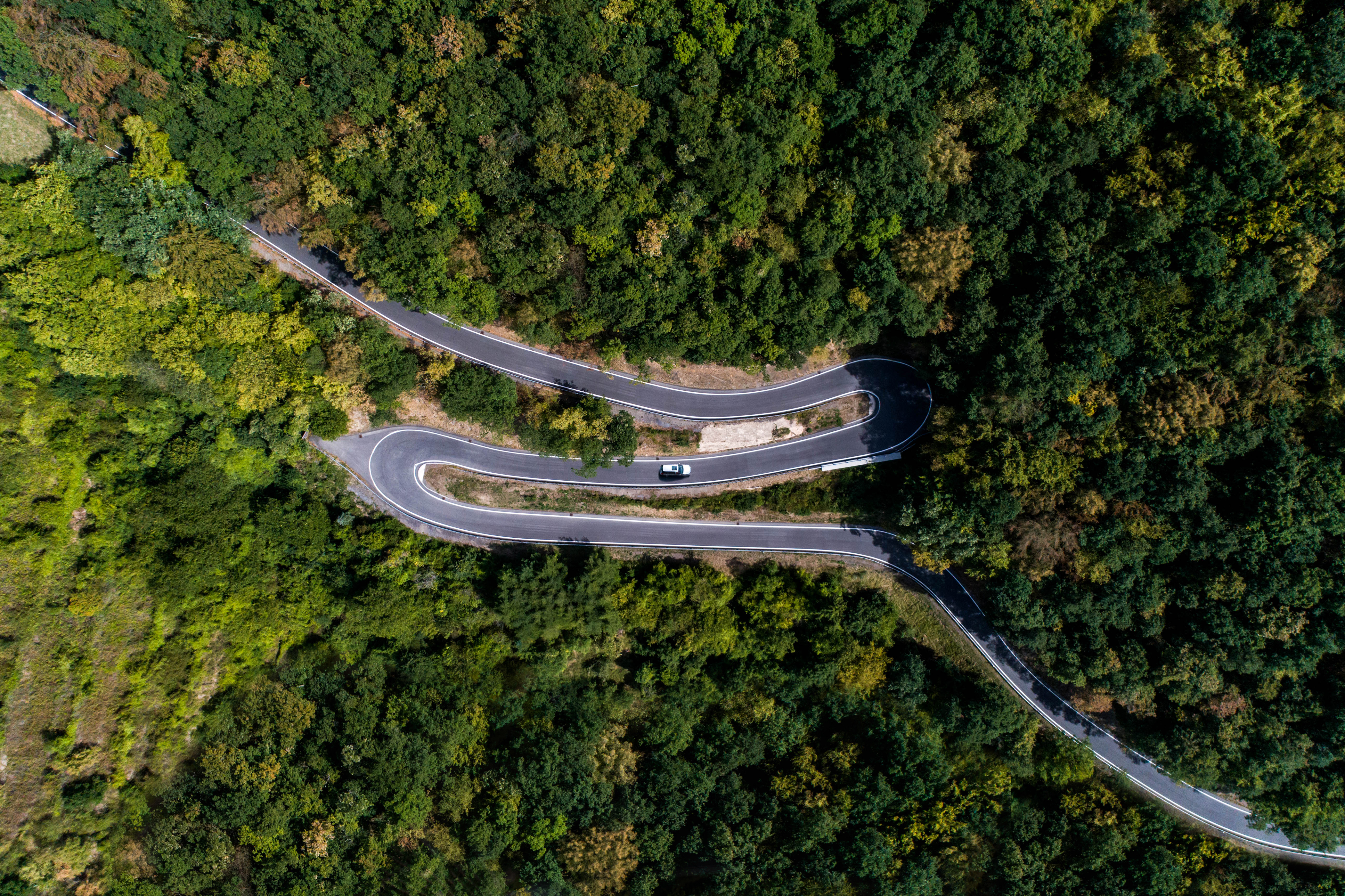 Winding road serpentine from a high mountain pass in the mosel village Brodenbach Germany Aerial view.