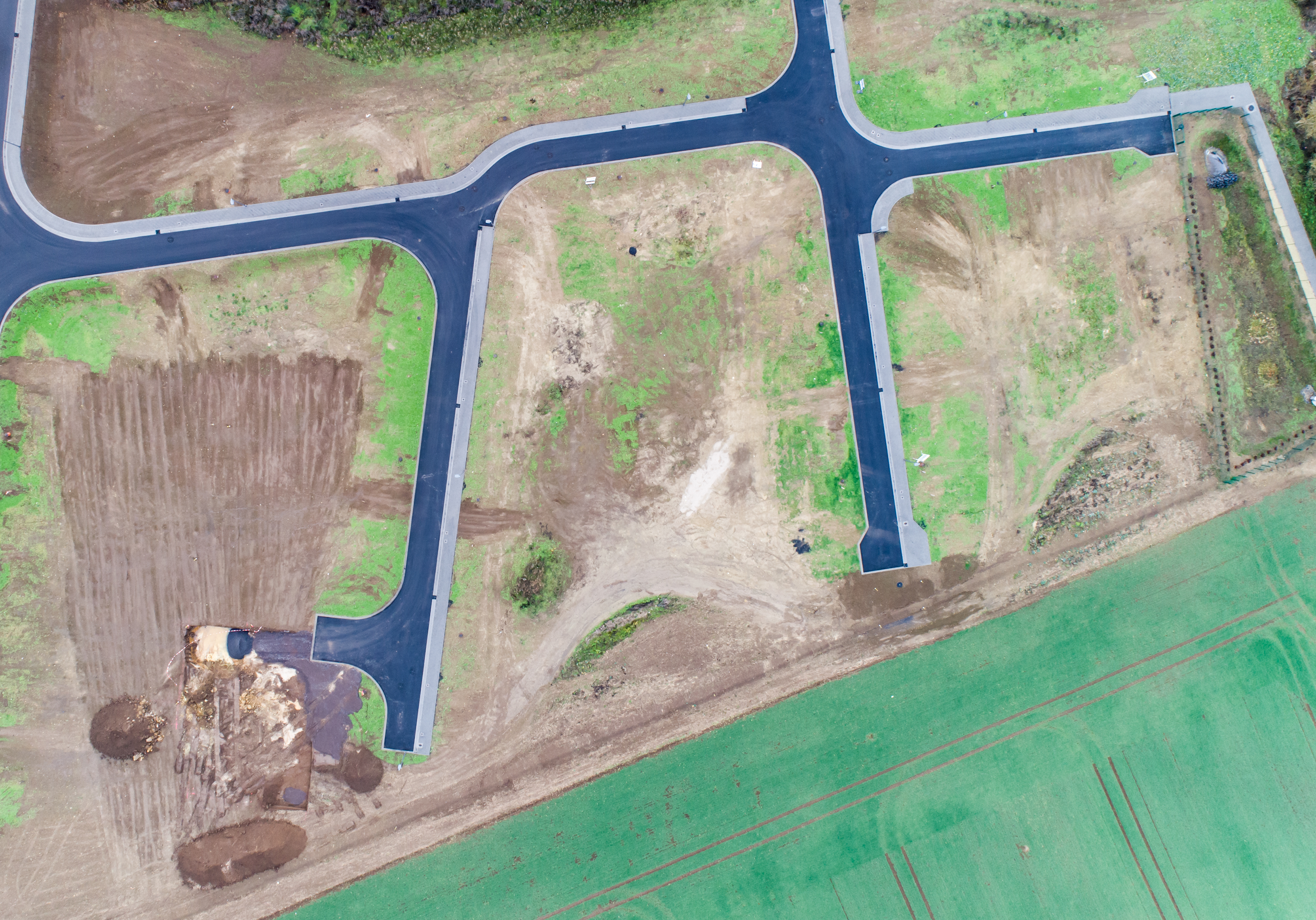 Aerial view of road streets guidelines new development area for real estate mome building arable area green Germany.