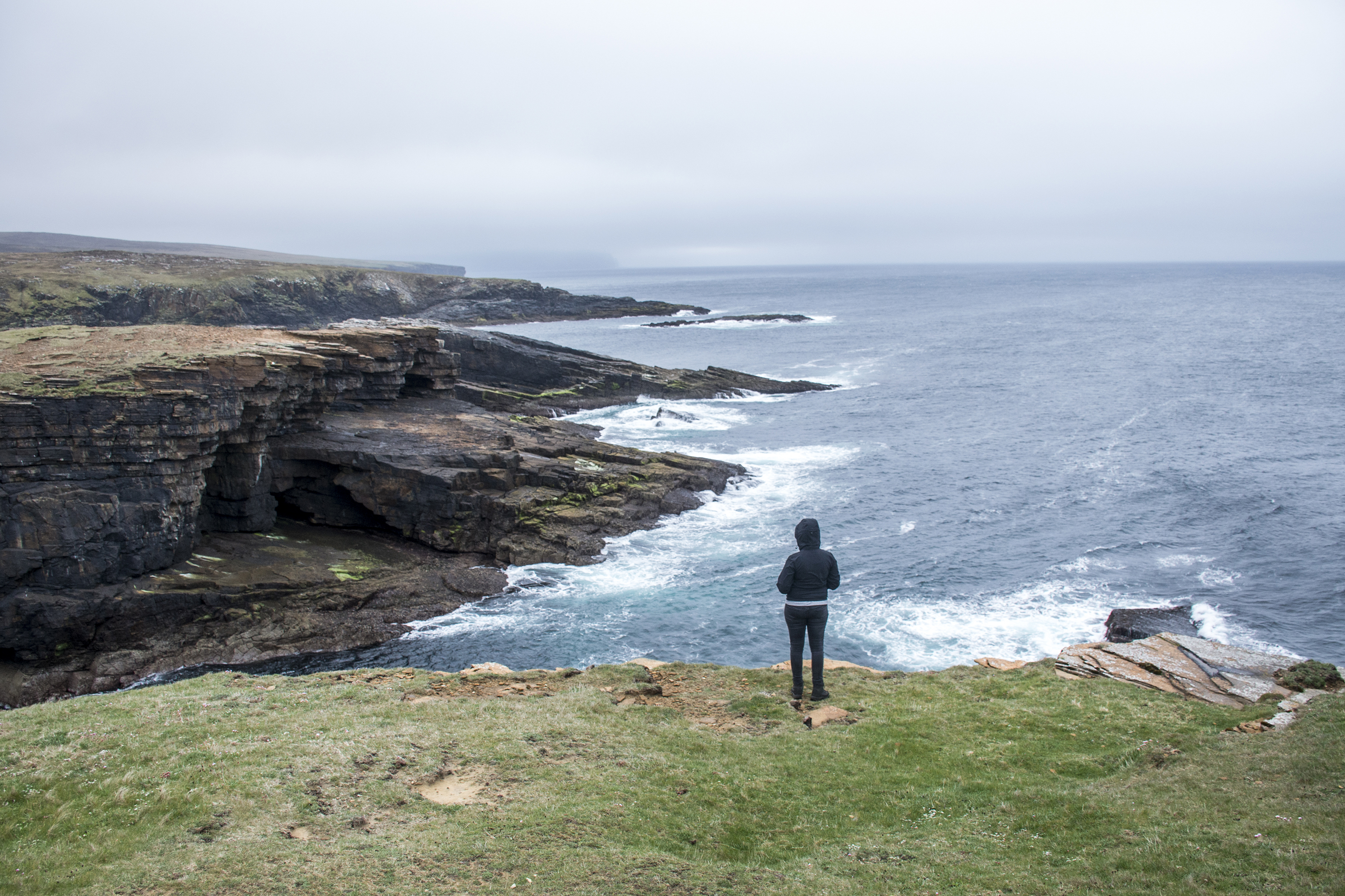 Girl looking Panorama of Orkney coastline Yesnaby cliff landscape 2
