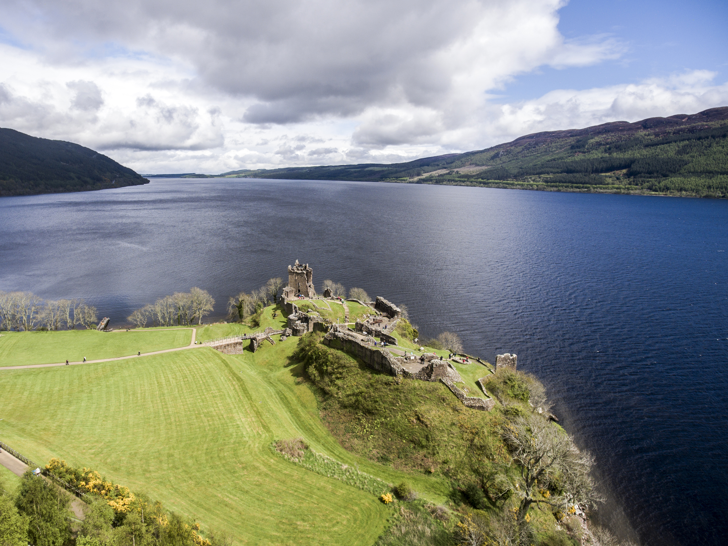 The famous lake Loch Ness aerial shot green Scotland United Kingdom