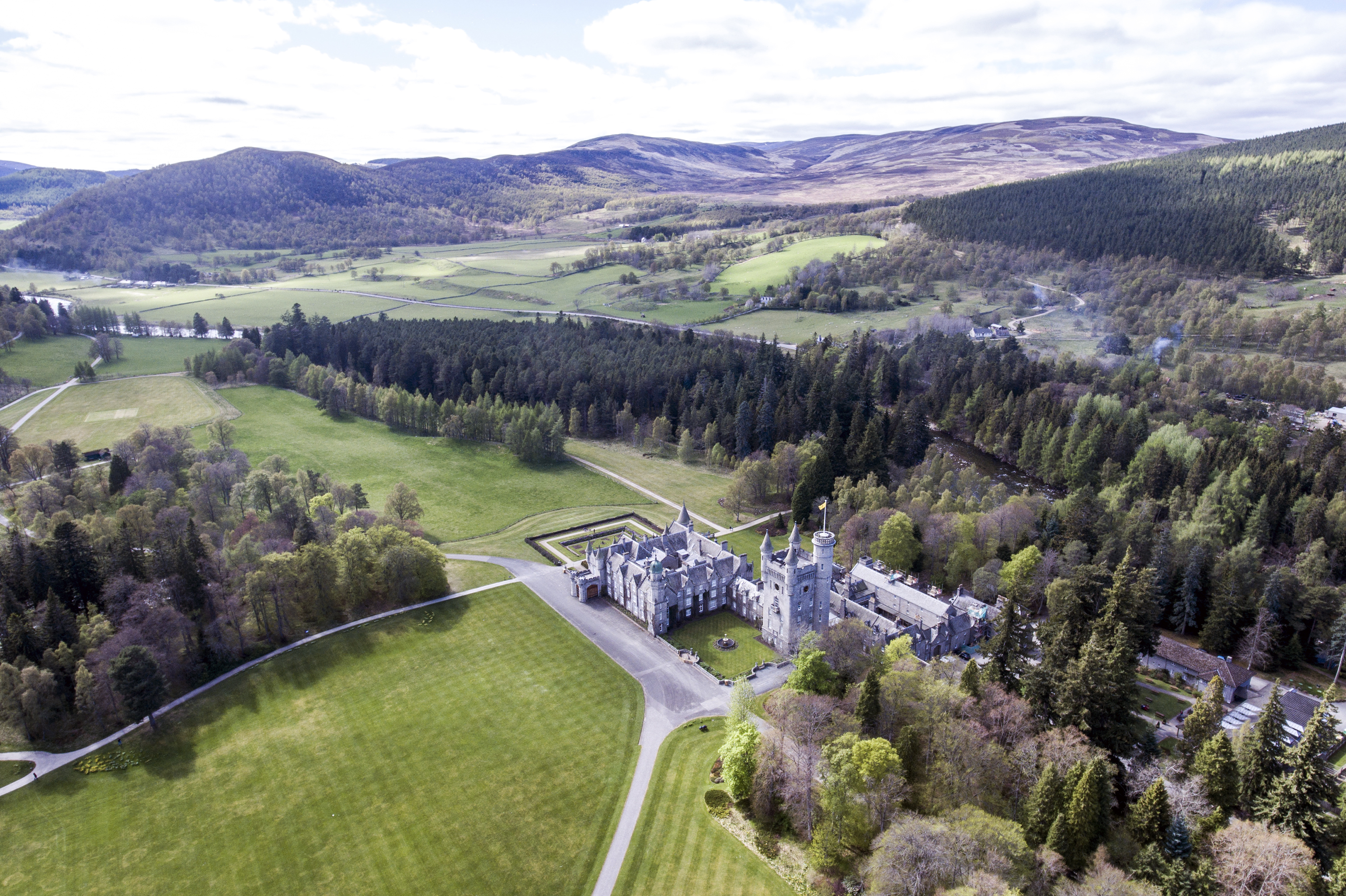 Aearial shot of a Park in a forest Landscape castle Scotland Great Britain